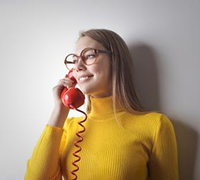 Canva - Woman in Yellow Sweater Holding Red Telephone